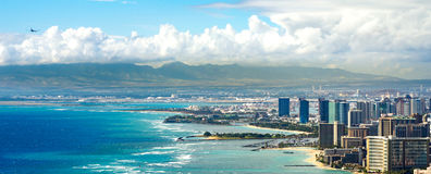 Honolulu Coastline with an Airplane Flying.  Royalty Free Stock Images