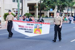 Honolulu, Hawaii, USA - May 30, 2016: Waikiki Memorial Day Parade. Soldiers carry a banner announcing Teila Tuli, also known as Taylor Wily is an American actor Royalty Free Stock Image