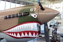 World War II plane with nose art. HONOLULU, HI, UNITED STATES - June 26, 2011: Nose art on a world war II era plane with sharks teeth motif stock images