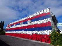 Hawaii State Flag done in Graffiti style. Honolulu - January 25, 2016: Hawaii State Flag done in Graffiti style on side of Kaka'ako Pet Hospital Building royalty free stock images