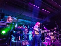 Mike Love Band plays music indoors. Honolulu - June 7, 2017: Mike Love Band plays music indoors with cool lighting at Crossroads at Hawaiian Brians in Honolulu stock photography