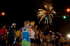 Honolulu Marathon 2009. Fireworks lit up the sky as runners raced each other at the start of the 37th Honolulu Marathon  at 5 a.m. at Ala Moana Boulevard Royalty Free Stock Photography