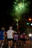 Honolulu Marathon with Firework. Fireworks lit up the sky as runners raced each other at the start of the 37th Honolulu Marathon  at 5 a.m. at Ala Moana Stock Photos