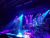 Mike Love Band plays music indoors. Honolulu - May 24, 2017: Mike Love Band plays music indoors with cool lighting at Crossroads at Hawaiian Brians on May 24 stock image
