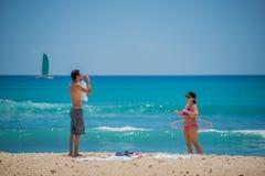HONOLULU, USA - People having fun at waikiki beach Stock Image