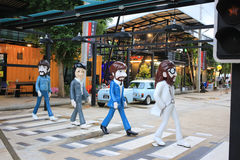 Honom Beatles Abbey Road zebramarkering glasfiberstaty Arkivbild