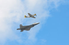 Honor Flight. An honor flight, commemorating the heritage of generations of design and development in US air power, featuring a P-51 Mustang and an F-22 Raptor Stock Image
