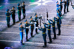 """The Honor Guard and the Band of the Presidential Regiment """"Aibyn"""" of Republic of Kazakhstan at the Red Square. MOSCOW, RUSSIA - AUGUST 26, 2016: Spasskaya Stock Photos"""