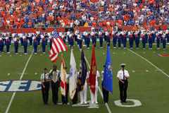 Honor Guard Fla. v. Kentucky. Honor Guard with UF Marching Band before the FL. v Kentucky Game at The Swamp, Gator Country. University of Florida Gainesville FL Royalty Free Stock Photography