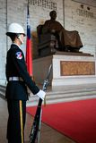 Honor guard with rifle and bayonet in front of statue at National Chiang Kai-shek memorial hall in Taipei Taiwan. 11 February 2018, Taipei Taiwan: Honor guard royalty free stock photo
