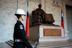 Honor guard with rifle and bayonet in front of statue at National Chiang Kai-shek memorial hall in Taipei Taiwan. 11 February 2018, Taipei Taiwan: Honor guard royalty free stock image