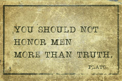 Honor men Plato. You should not honor men more than truth - ancient Greek philosopher Plato quote printed on grunge vintage cardboard Royalty Free Stock Images