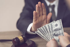 Honorable judge. Detail of a judge refusing a bribery money. Selective focus Stock Photos