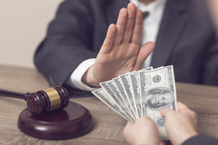 Honorable judge. Detail of a judge refusing a bribery money. Selective focus Stock Image