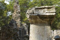 Honorary inscription on a stone column. Stock Photography