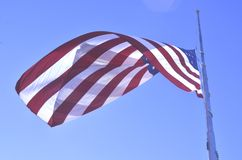 American flag flying at half staff or half mast Stock Images