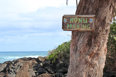 Honu Parking Sign on Turtle Beach in North Shore, Oahu, Hawaii Stock Photo