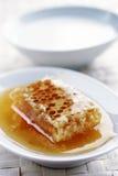 honung mjölkar arkivfoton