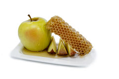 Honung och äpplet är symboler av roshhashanah Royaltyfri Fotografi