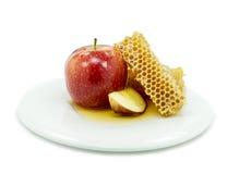 Honung och äpplet är symboler av roshhashanah Arkivbilder