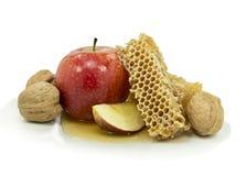 Honung och äpplet är symboler av roshhashanah Arkivfoton