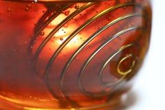 Honung och Honey Stick på vit bakgrund arkivfoto