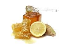 Honunghårkam och banken av honung, Arkivbild