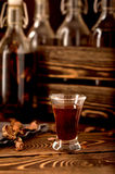 Hooch moonshine alcohol  herbs Stock Image