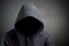 Hood. The person with the latent person. A black background Royalty Free Stock Image