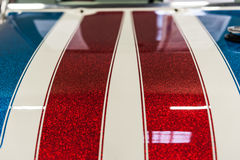 Hood of a blue,red and white sport car Royalty Free Stock Photos