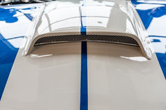 Hood of a blue and white sport car Royalty Free Stock Photography