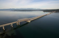 Hood Canal Bridge Puget Sound Shoreline Olympic Mountain Range. Commuters move across the Puget Sound on the Hood Canal Bridge connecting Olympic and Kitsap Royalty Free Stock Images
