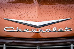 Hood emblem of Chevrolet in raindrops. Royalty Free Stock Photos