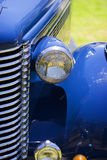 Hood and fender antique car. Partial view of the grill, hood, headlight and fender of an antique car Royalty Free Stock Photography
