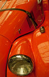 Hood and Fender of Orange Couple. The front end of a classic orange roadster Stock Photography