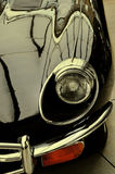 The hood and headlight stylish black retro car. Retro style. Royalty Free Stock Images