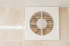 Free Hood In The Bathroom To Eliminate Dampness And Odor. The Wall Is Tiled, Yellow Engine Blades Royalty Free Stock Images - 161410169