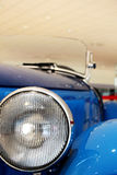 Hood and light of a vintage car Stock Images