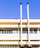 Hood of old style air condition system at old building on shiny day. Thailand Royalty Free Stock Photo