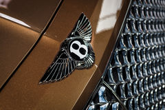 Hood ornament of large luxury crossover SUV Bentley Bentayga, 2016. Royalty Free Stock Image