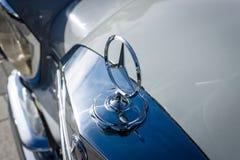 Hood ornament of Mercedes-Benz three-beam star, closeup. Stock Photos