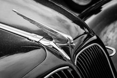 Hood ornament of the mid-size luxury car Citroen Traction Avant. BERLIN, GERMANY - MAY 17, 2014: Hood ornament of the mid-size luxury car Citroen Traction Avant stock image