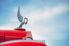 Hood ornament of a red 1936 Packard Stock Images