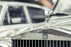 Hood ornament on a vintage Rolls Royce car. Royalty Free Stock Image