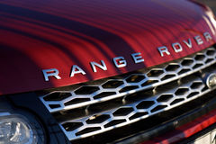 Hood of the Range Rover car. St. Petersburg, Russia - August 3, 2015: Red hood of the Range Rover car in a parking lot closeup. About 11'600 Land Rover cars was Royalty Free Stock Photography