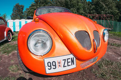 Hood of the red orange beetle machine. Russia, Saint-Petersburg July 2016. Royalty Free Stock Photos