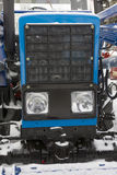 The hood of tractor - blue modern agricultural equipment. Close up royalty free stock photo