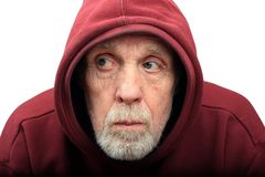 Hooded. Elderly Man with Interesting Face Wearing a Hoodie Royalty Free Stock Photo
