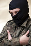 Hooded angry teenager. Portrait of hooded teenager boy scout stock image