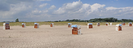 Hooded beach chairs Royalty Free Stock Photography